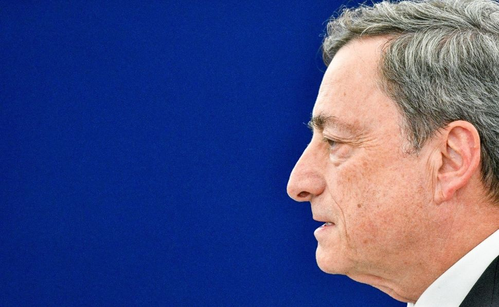 The head of Mario Draghi, President fo the European Central Bank. Blue background.