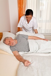 Nurse helping an elder