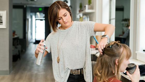 Hairdresser attending client