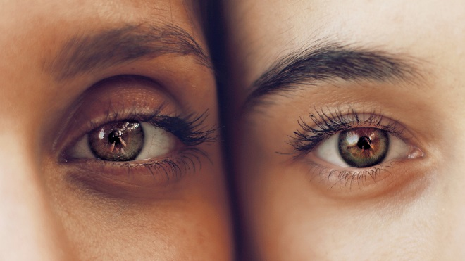 close-up of two people's eyes, side by side