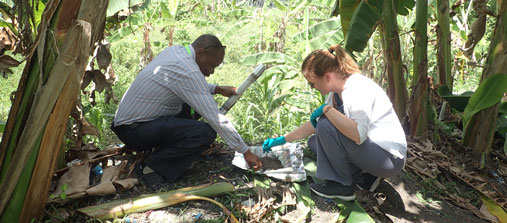 Two toxicologists (man and woman) working with waste in the woods Tanzania. Photo: Paul Wenzel Geissler