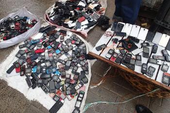 Used cell phones on the streets of Tanzania. hoto: Samwel Ntapanta