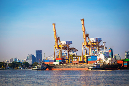 Industrial port with container ship and cargo. Photo: Colourbox