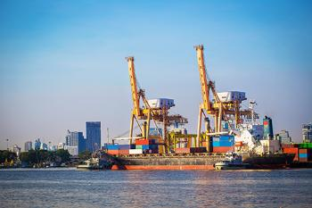 Industrial port with container ship.