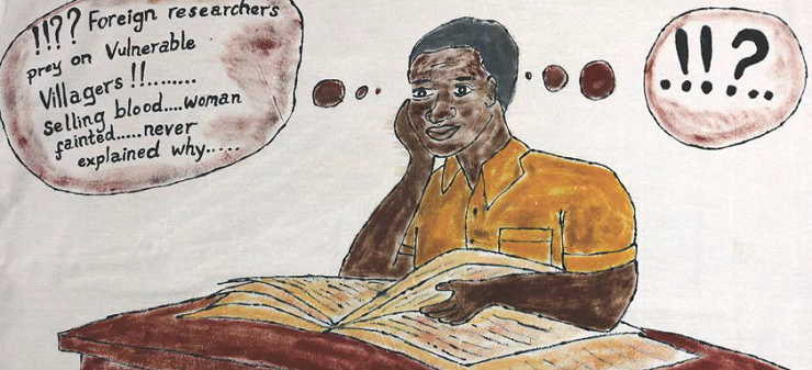 African man reading a book.