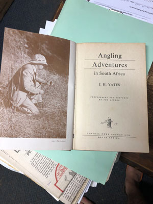 "Picture of an old, black-and-white book named ""Angling Adventures in South Africa"", written by Yates. On the left page there is a picture of a man in a flyfishing costume. Photo: Knut Gunnar Nustad"