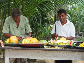 Men preparing food offerings.