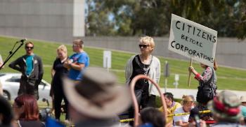 The conditions for change towards a more sustainable life are currently not be the best. Alliances between politicians and corporations overrun local communities. Here from a march in Canberra, 2014. Photo: David Burke, flickr