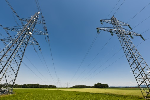 Power lines in a summer landscape with clear sky